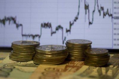 Эксперт рассказал, как отразится на мировой экономике скупка золота Россией