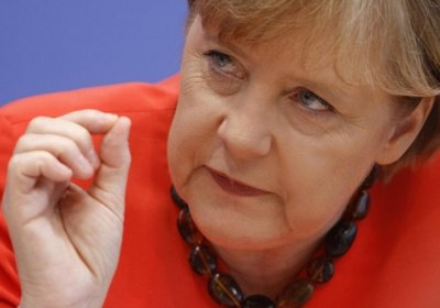 Меркель обещает Украине подписание ассоциации на следующей неделе, а Путину грозит санкциями