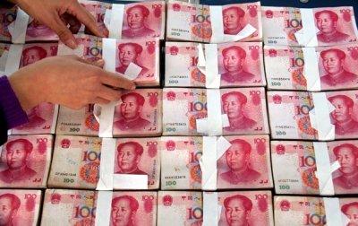 Центробанк Китая снизил курс юаня до минимума августа 2011 года
