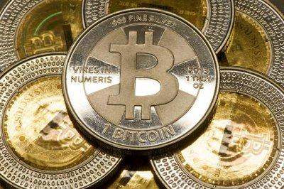 Стоимость биткоина приблизилась к 10 тыс долларов