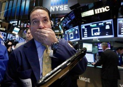 Индекс Dow Jones за сутки обрушился более чем на 700 пунктов