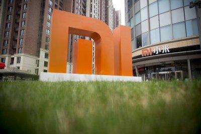 Компания Xiaomi в 2018 году начнет раздавать клиентам лишние деньги